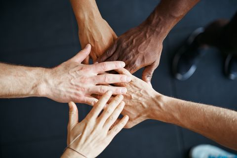 diverse-people-standing-with-their-hands-together-2021-04-02-21-43-12-utc.jpg
