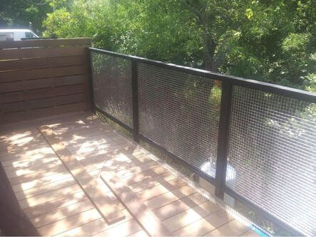 Deck almost completed with Mesh Fence.jpg