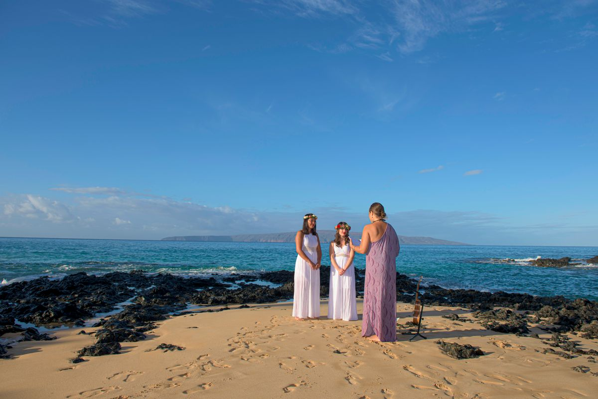 Couple on beach getting married