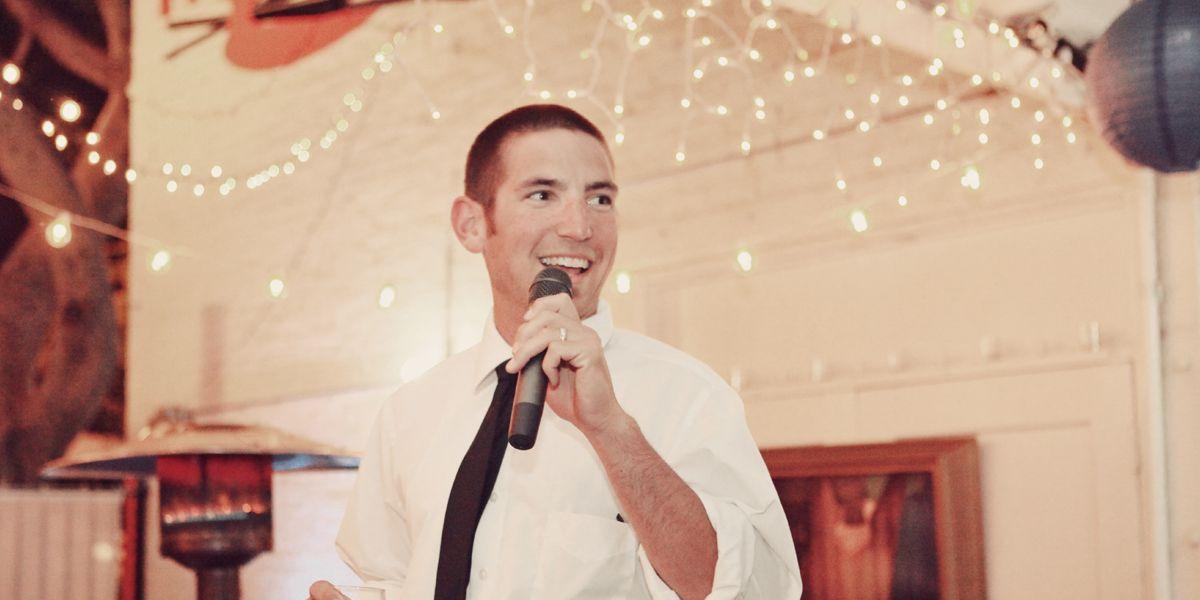 man giving a speech at wedding