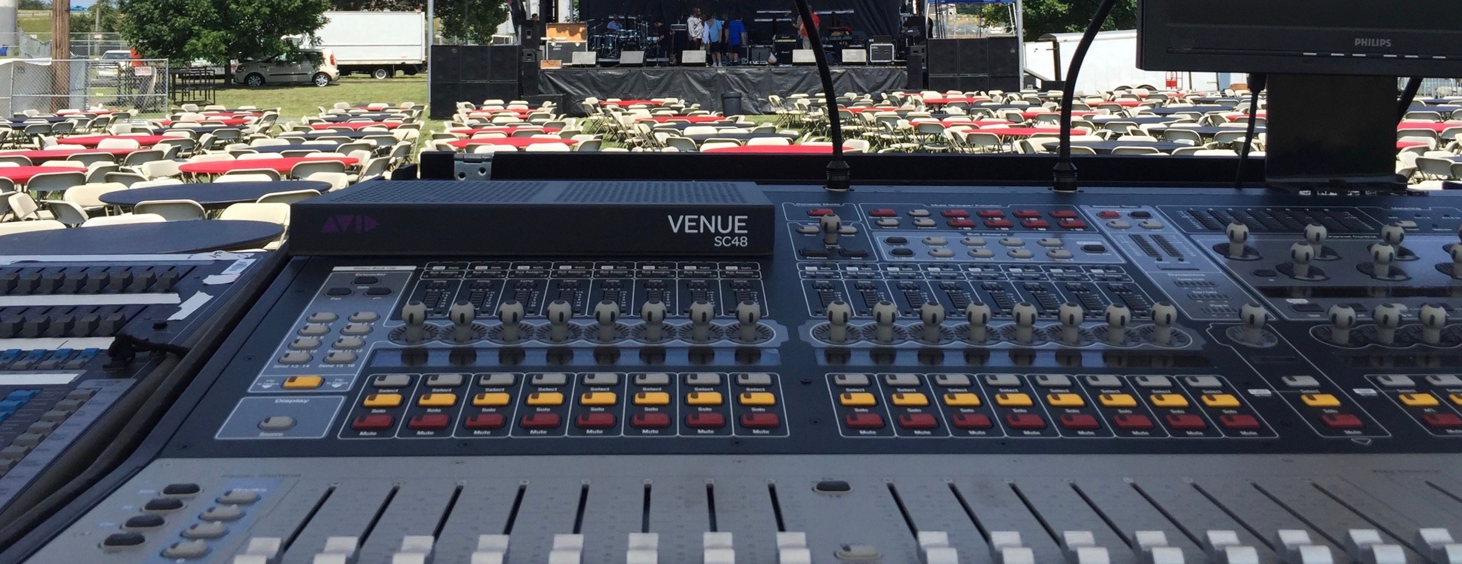 Close up of audio mixer at an outdoor concert