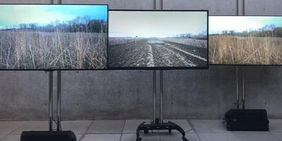Three flat screen TV display