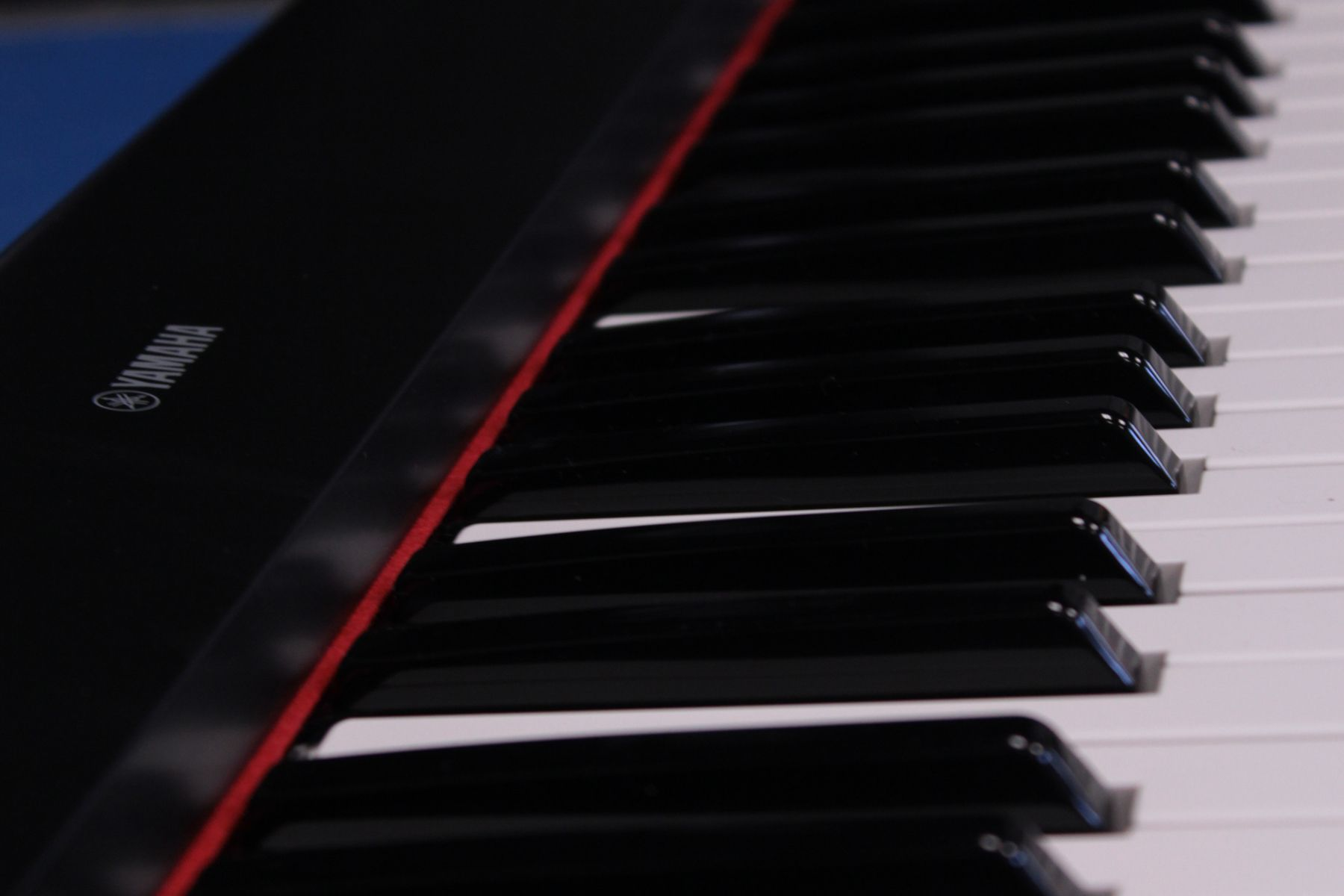 Close up of keys on a Yamaha keyboard