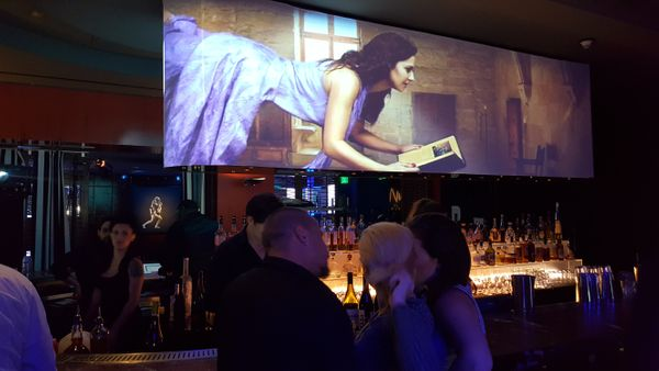 projection display behind bar