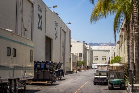 Outside of Warner Bros Studios with Palm Trees and Golf Carts