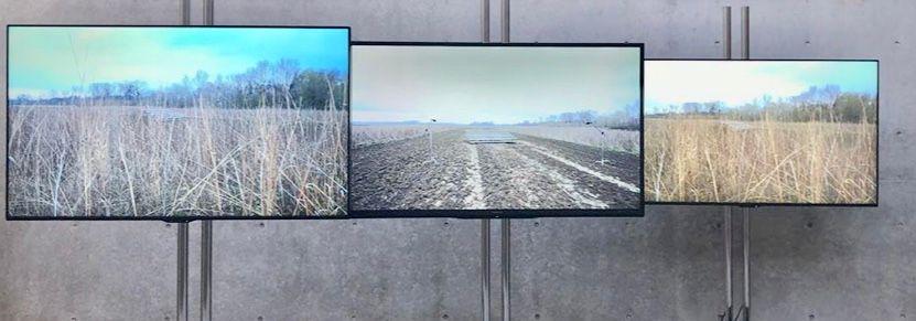 Three flat-screen TVs side by side