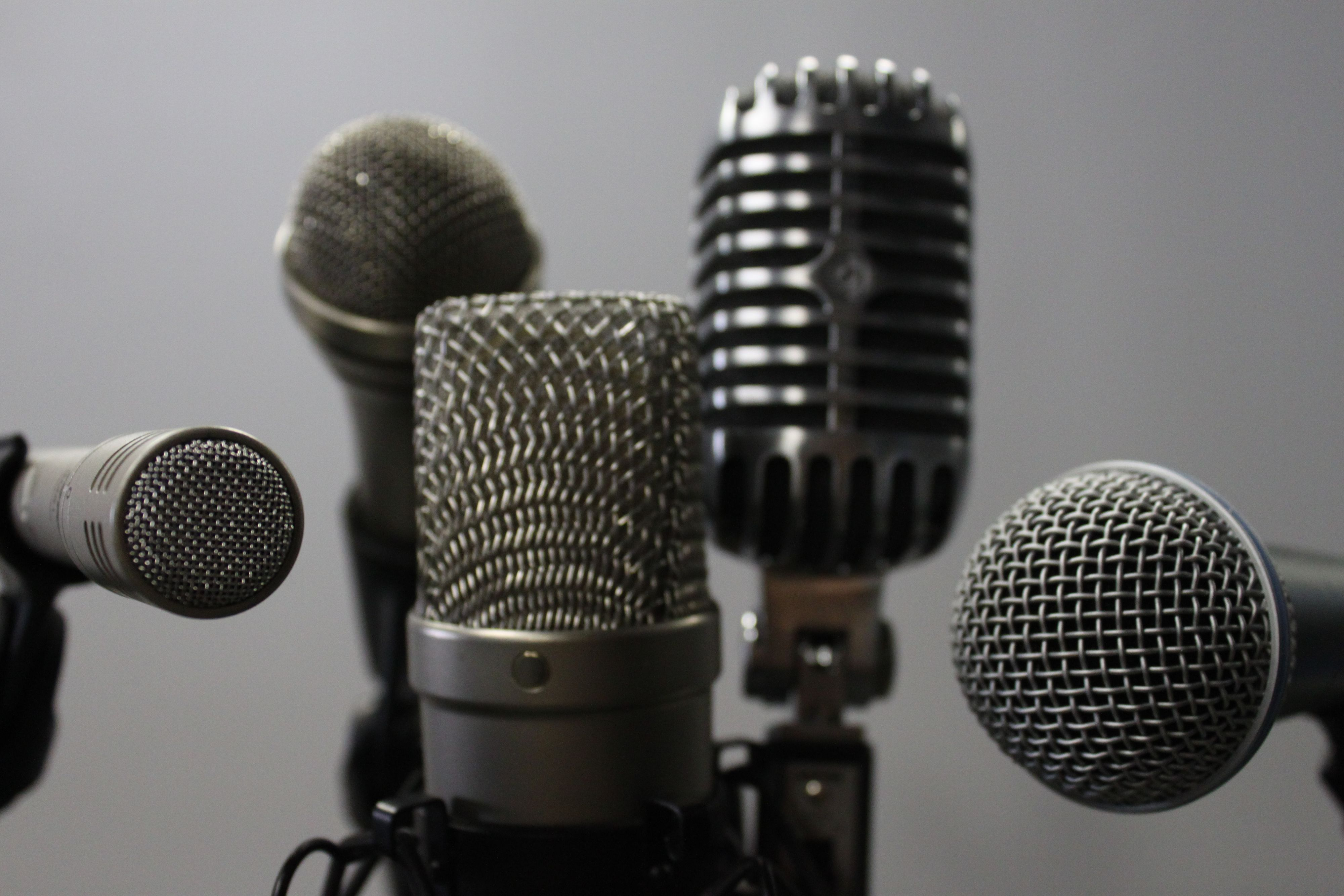 Close up of five different microphones