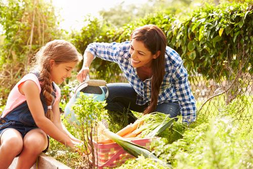 Mom-Daugher-Watering-Garden.jpg