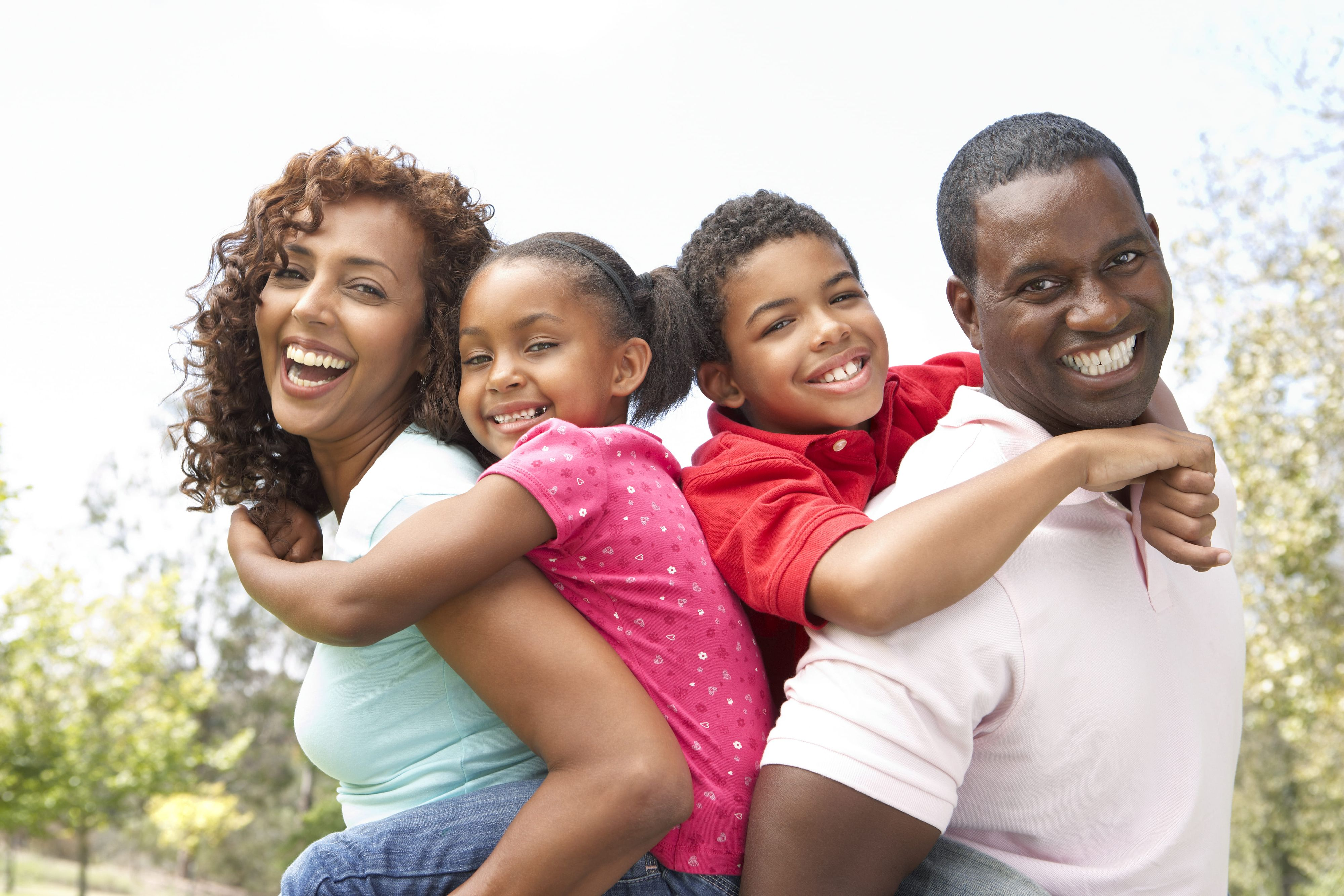 bigstock-Portrait-of-Happy-Family-In-Pa-13909304 (1) (1).jpg