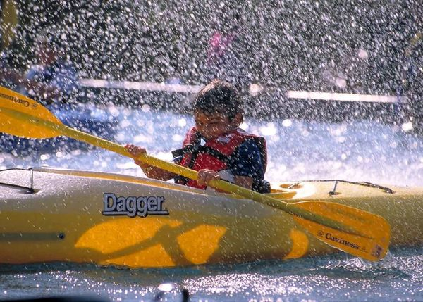 kid splashing in kayak.jpg