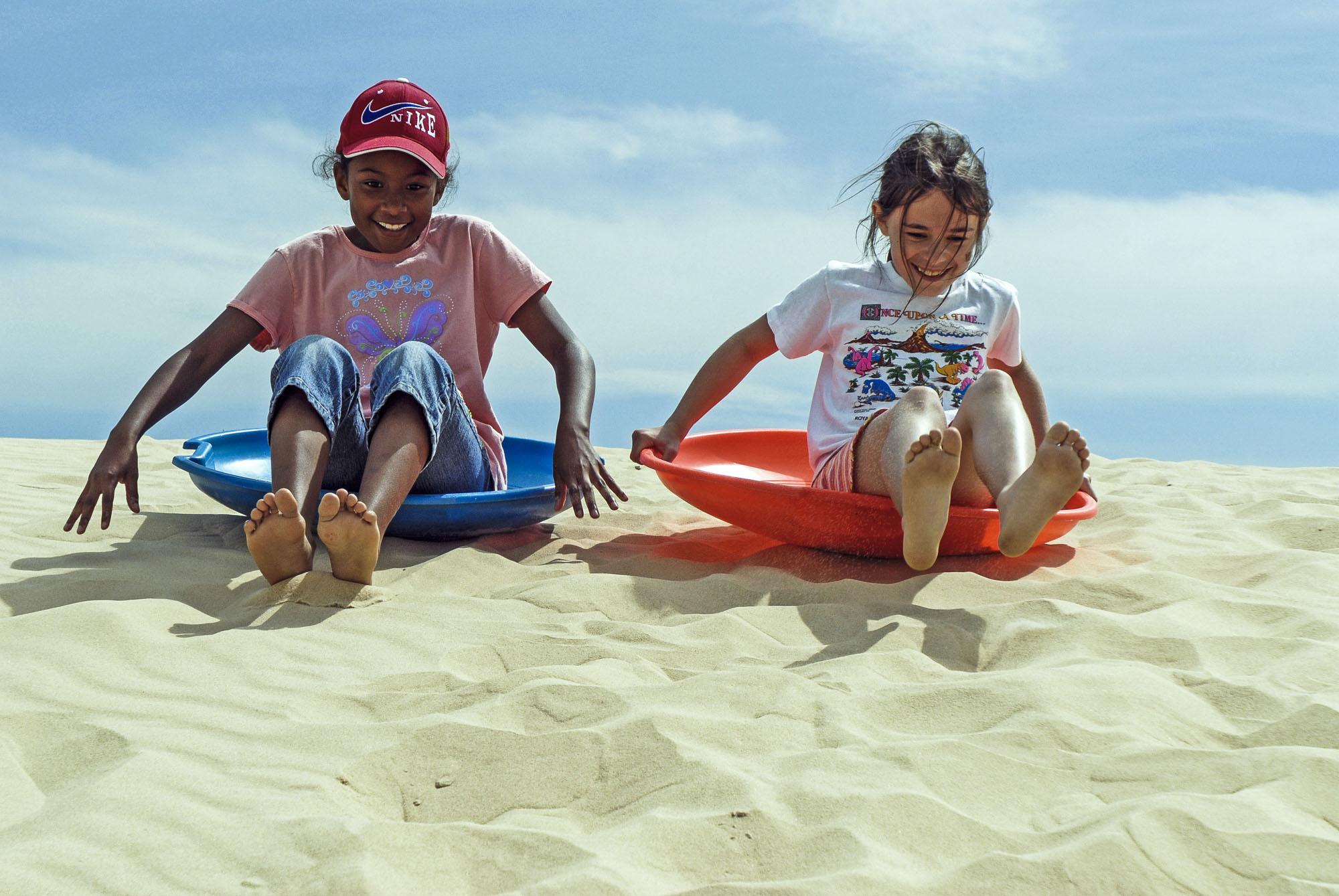 girls laughing, surfing.jpg