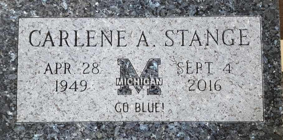 Blue Pearl Granite Tombstone with Michigan University Emblem.