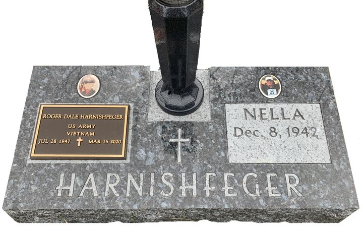 Blue Granite Companion Stone with Cross, Vase, Veteran's Plaque and Ceramic Pictures.