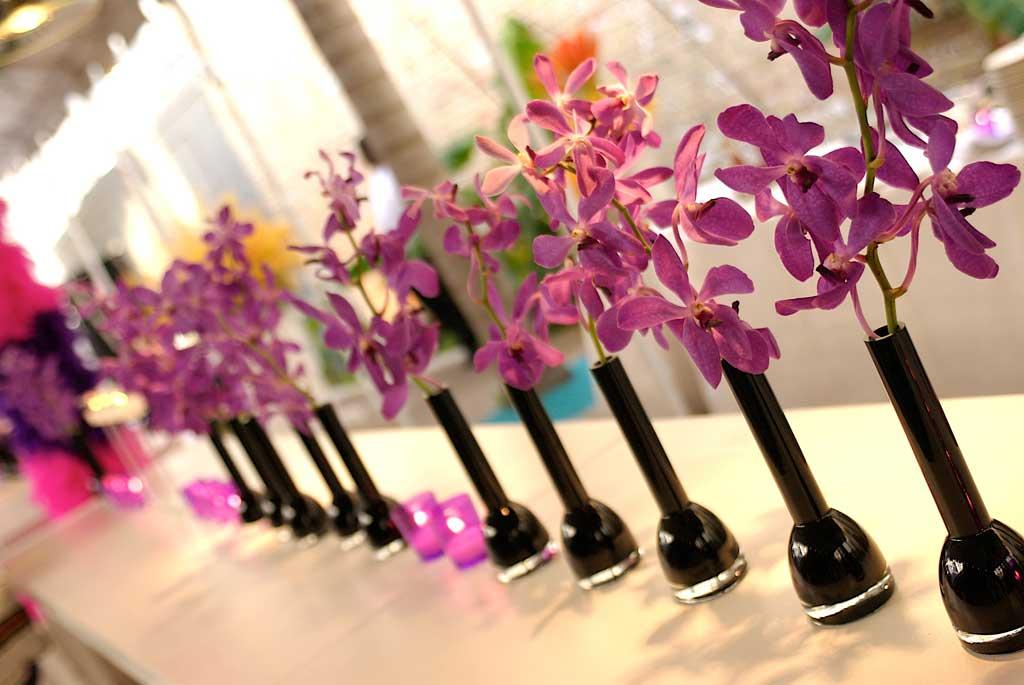 flowers in black vases
