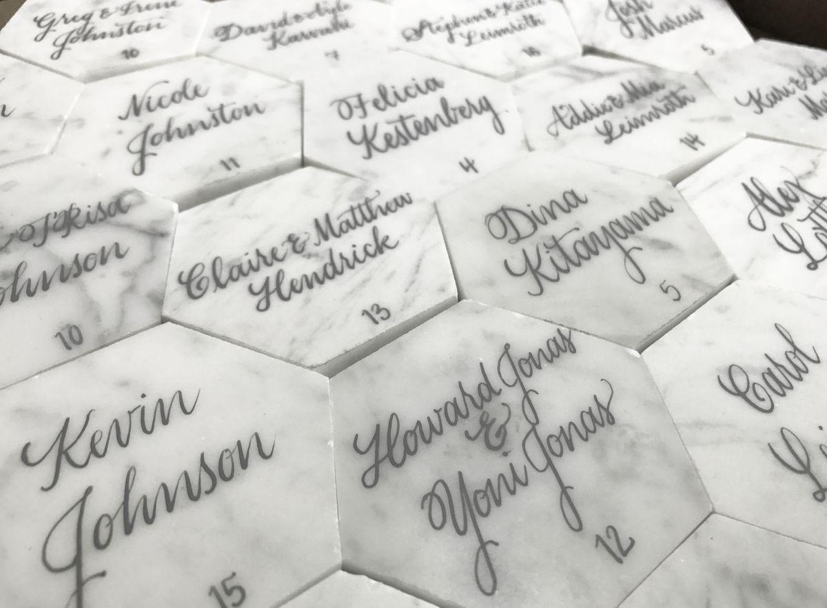 Wedding Escort Cards - Gray Ink on White Carrara Marble Hexagon Tiles.jpeg