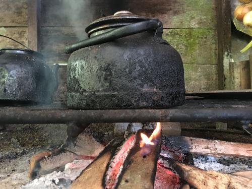 teapot heating on outdoor kitchen stove