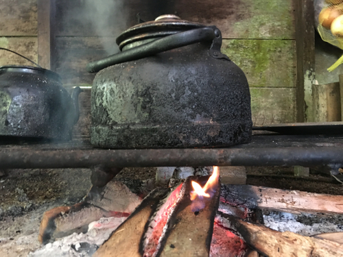 teapot heating on outdoor kitchen stove in costa rican rainforest