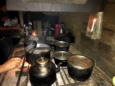 cooking on open fire kitchen stove in rainforest
