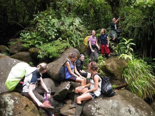 hikers relaxing in rainforest at la danta