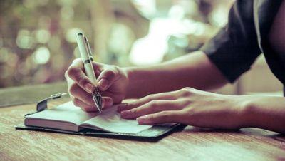 woman writing small.jpg