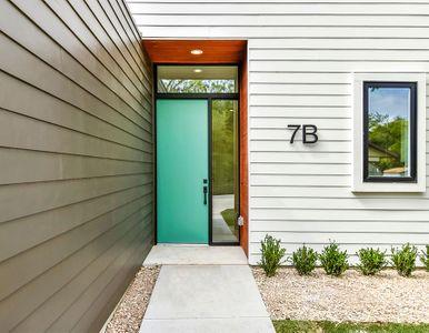 Bungalow front entry green door