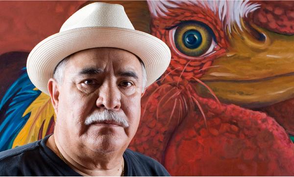 """Joe Lopez in front of """"El Corazon del Gallo"""""""
