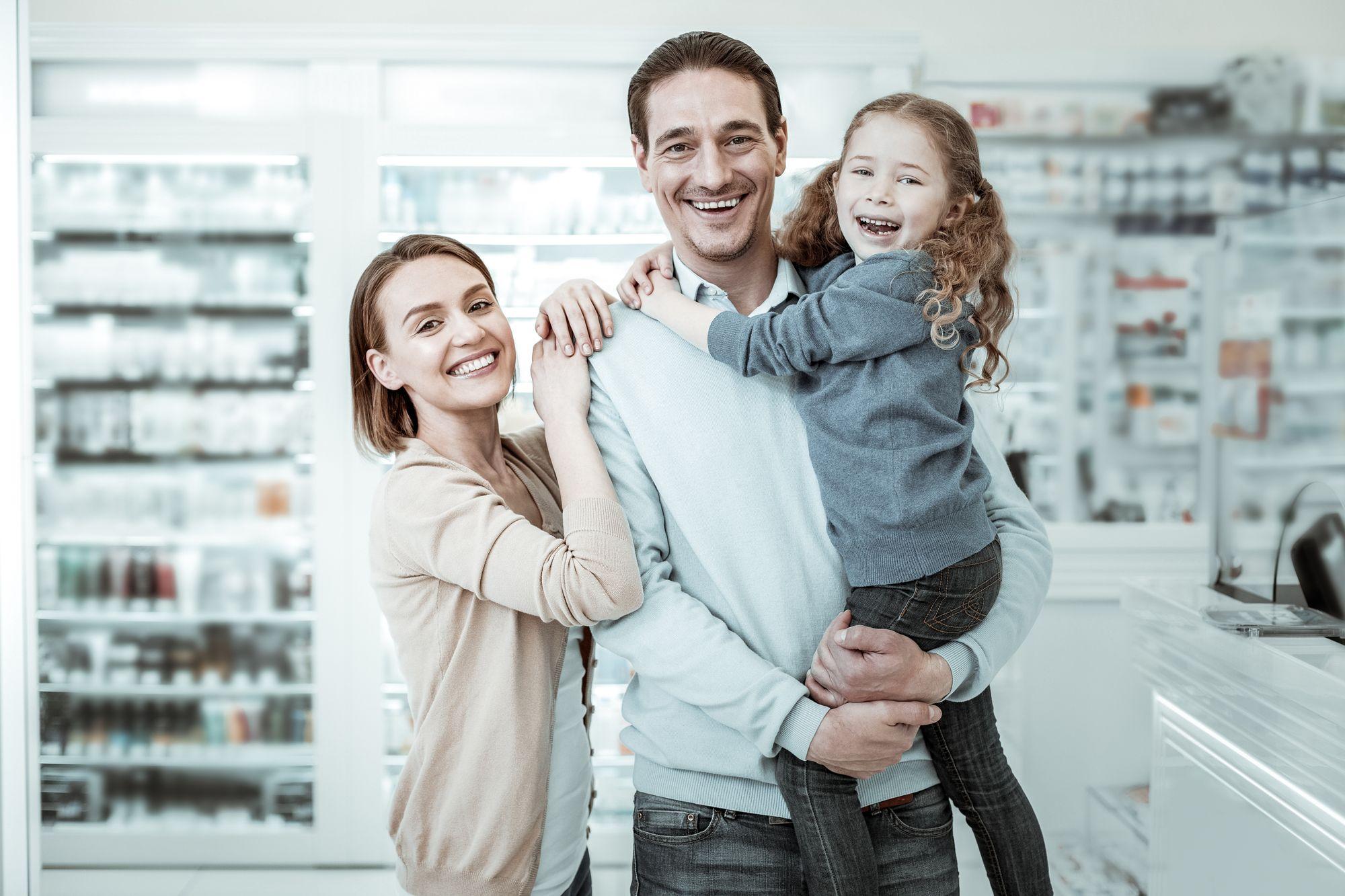 Family cuddles in pharmacy