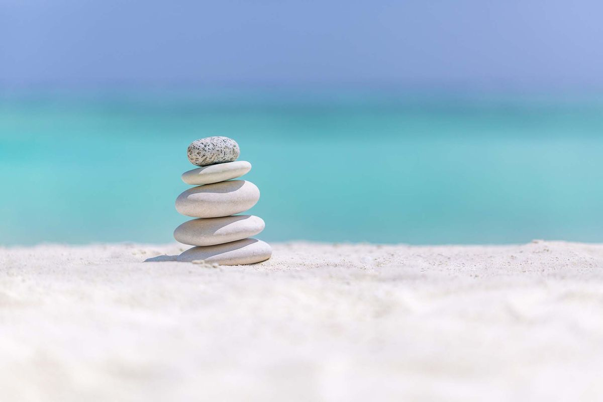 bigstock-Zen-Stones-On-Tropical-Beach-F-268500223.jpg