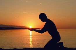 man holding sun.jpg