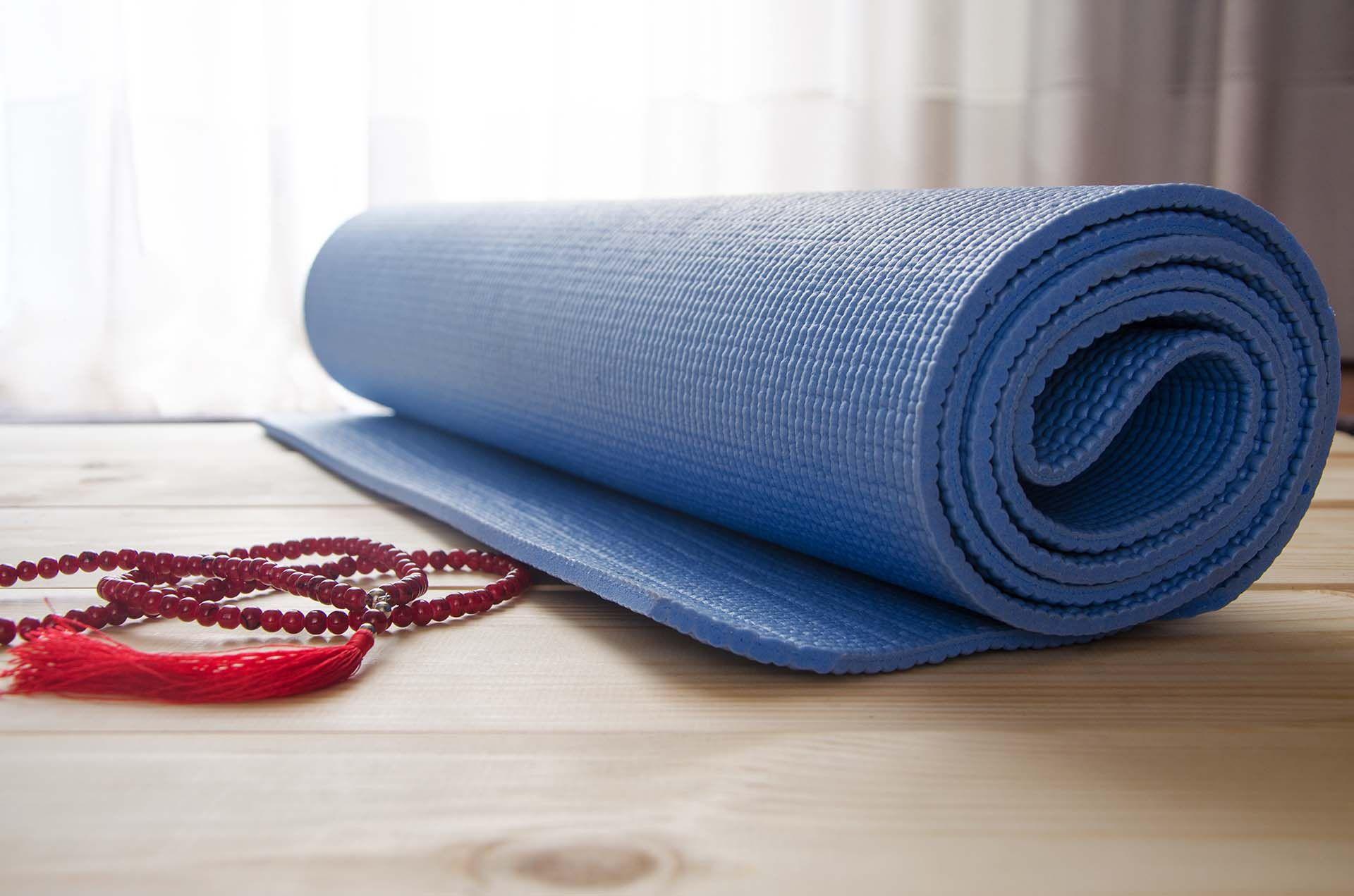 bigstock-Yoga-Mat-With-Mala-Beads-153546827.jpg