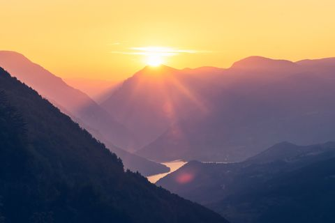bigstock-Sunset-In-Mountain-Landscape--310299535.jpg