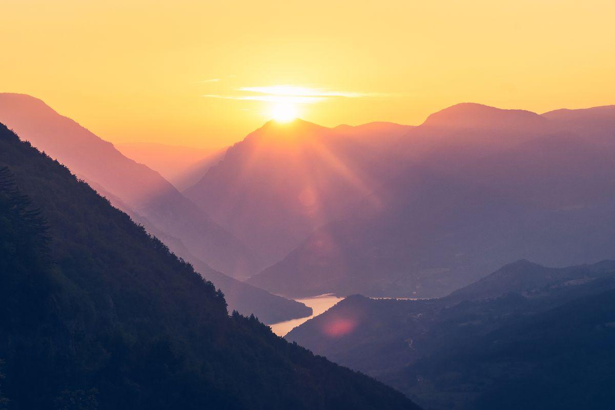 bigstock-Sunset-In-Mountain-Landscape--310299535.jpg