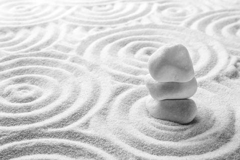 bigstock-Stack-Of-White-Stones-On-Sand--347714602.jpg