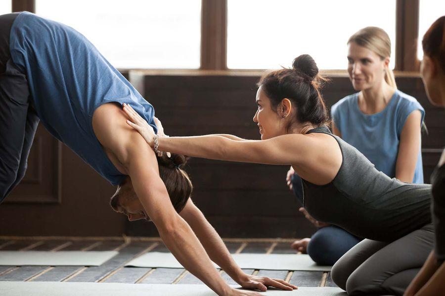 bigstock-Smiling-Yoga-Teacher-Or-Pilate-227581126.jpg