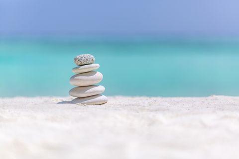 bigstock-Zen-Stones-On-Tropical-Beach-F-268500223.jpg