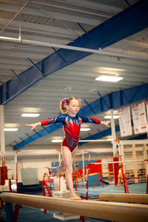 Young-Gymnast-Doing-Routine-on-Balance-Beam-167762234_2578x3867.jpeg