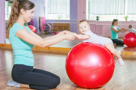 Mother-with-happy-baby-doing-exercises-with-gymnastic-ball-494570920_3500x2334.jpeg