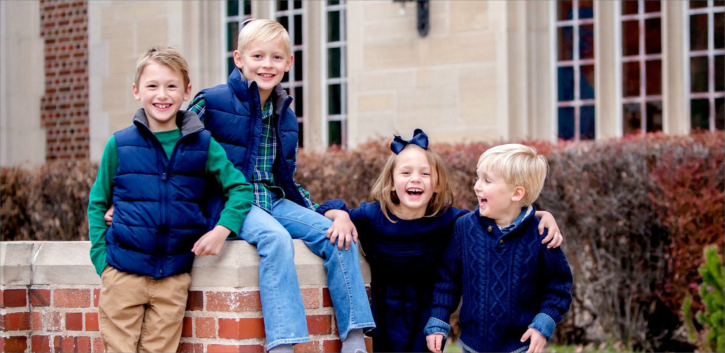 Cousins posing at DU Campus during a family photo shoot with Bloom Portraits.