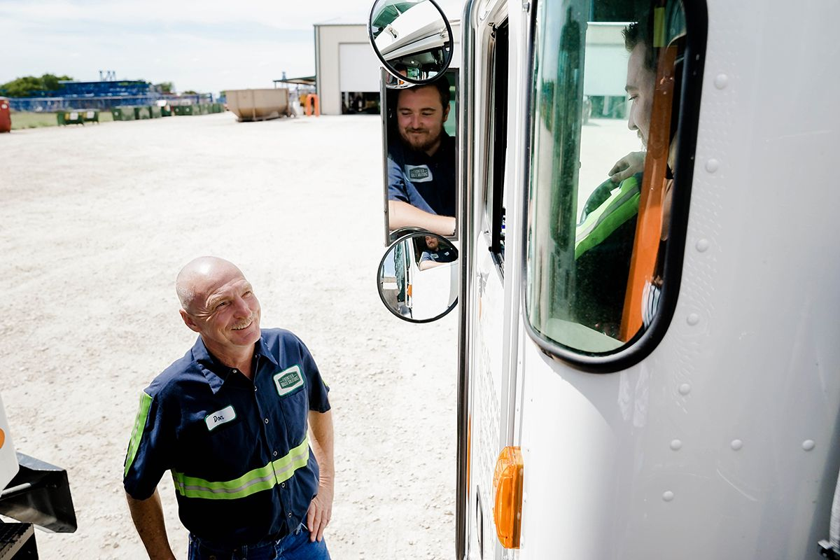 Frontier Waste truck and employees
