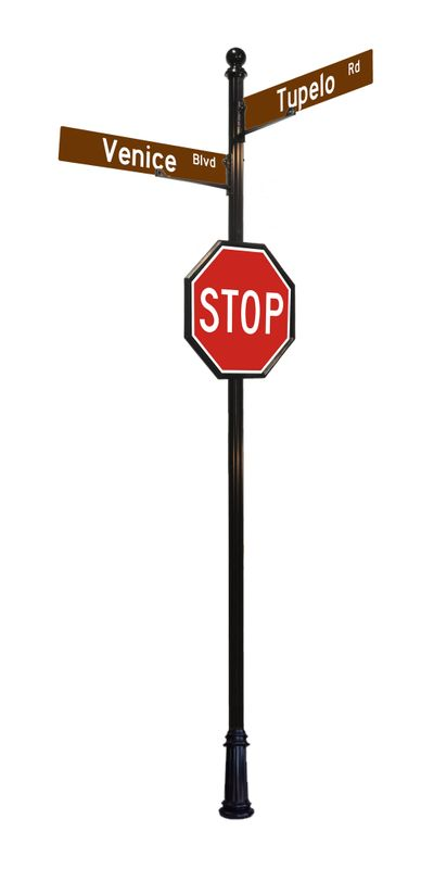Stop sign with street signs and ball finial