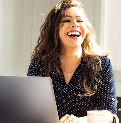 Woman smiling using laptop