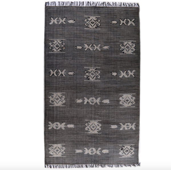 Faded Black Tribal Rug.png