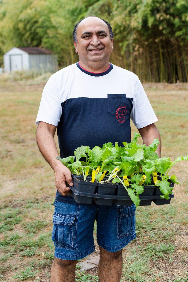 2019-09-19 STH Man Holding Plants IMG-01 WEB.jpg