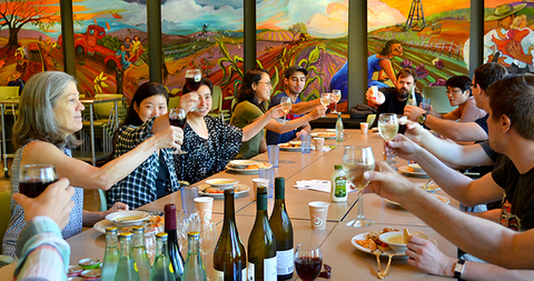 Renters-Toasting-with-Wine-in-Community-Room_WEBSITE.jpg