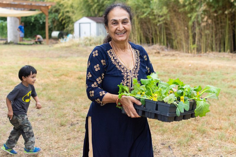 2019-09-19 STH Woman Holding Plants IMG-01 WEB.jpg