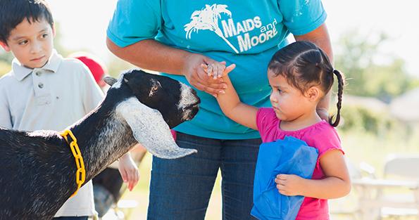 little-girl-with-goat_WEBSITE.jpg