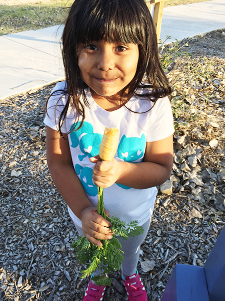 girl_smiling_with_carrot_450px.jpg
