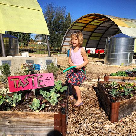 Girl Watering Children's Garden_450px.jpg