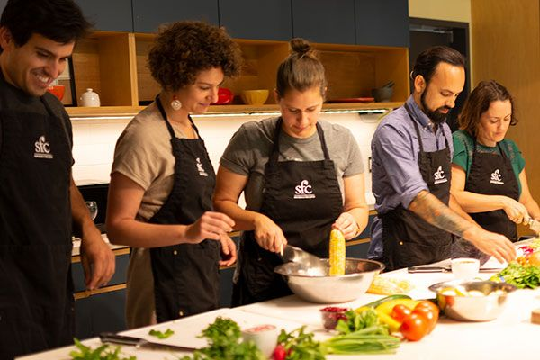 Kitchen Group Prepping Veggies