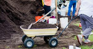 2017-09-28_Spread-the-Harvest-Wheelbarrow-Hauling-Compost_IMG-01_FACEBOOK.jpg